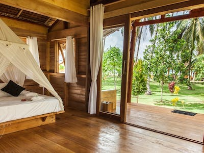 double bed and garden view jungle villa