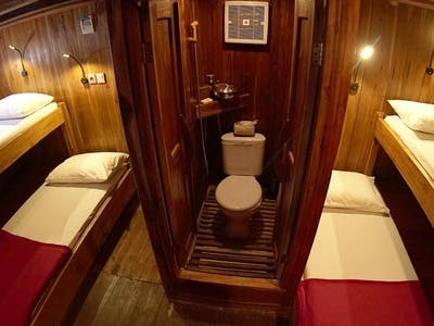 Room 1 with 5 single beds & private toilet