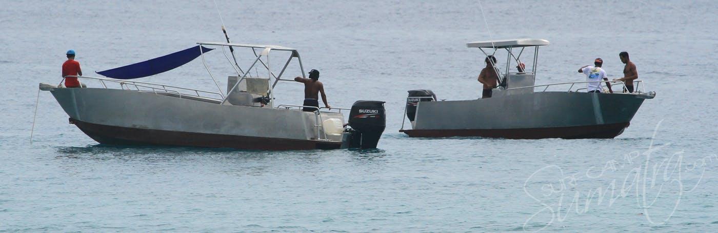 Telo surfing village boats